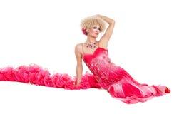 Drag Queen in Pink Evening Dress Lying on Floor Stock Photography