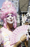 Drag queen in pink wig walking in the 37th Annual Provincetown Carnival Parade in Provincetown, Massachusetts. Royalty Free Stock Images