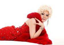 Drag Queen in Red Dress with Fur Lying on the Floor Stock Photos