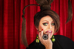 Drag Queen Staring. Beautiful drag queen staring and biting nails Royalty Free Stock Image