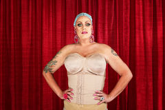 Drag Queen in Undergarments. Man in corset with tattoos on arms Stock Image