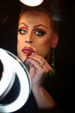 Drag Queen Using Lipstick Royalty Free Stock Photography