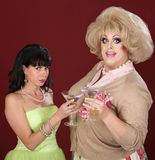 Drag Queen And Woman With Martini Stock Images