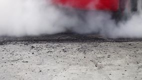 Drag racing car burn tire in preparation for the race. Drag racing car burns rubber off its tires in preparation for the race stock footage