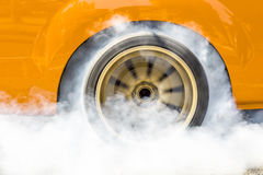 Drag racing car burning tire for the race Royalty Free Stock Photo