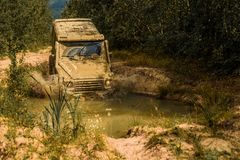 Drag racing car burns rubber. Extreme. Off-road car. Expedition offroader. Mud and water splash in off-road racing. Road. Adventure. Adventure travel royalty free stock images
