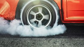 Drag racing car burn tires at start line. Drag racing car burns rubber off its tires in preparation for the race stock video footage