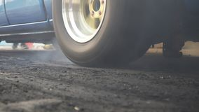 Drag racing car burn tire in preparation for the race. Drag racing car burns rubber off its tires in preparation for the race stock video