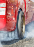 Drag racing car burns  tire for the race Stock Images