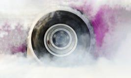 Drag racing car burns tires for the race Stock Photos