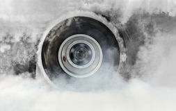 Drag racing car burns tires for the race Stock Images