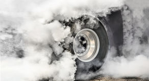 Drag racing car burns tires  for the race Stock Photo