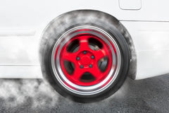 Drag racing car from side tire burnout in preparation for the ra Stock Photos