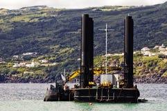 Draga e barca Imagem de Stock