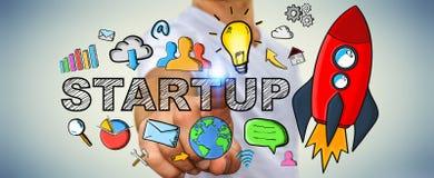 Dragen startup text för affärsman rörande hand och röd raket Fotografering för Bildbyråer