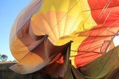Dragging Deflating Hot Air Balloon Stock Photo