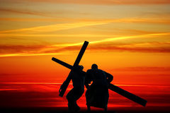 Dragging a wooden cross Stock Photo