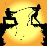 Dragkamp mellan mannen och kvinnan Royaltyfri Fotografi