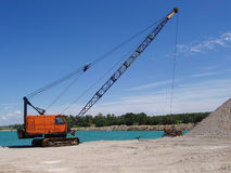 Dragline. Pulling out gravel at underwater gravel pit Stock Images
