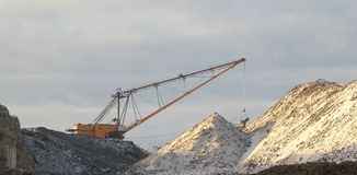 Dragline in action. Dragline in open cast mining quarry Stock Photo