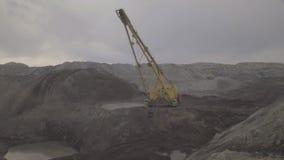 A dragline excavator working on development of open fields. stock video footage