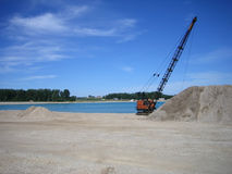 Dragline at gravel pit. Dragline pulling gravel out of water at gravel pit Royalty Free Stock Image