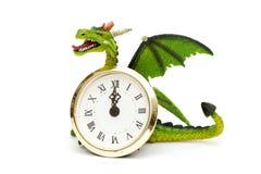 Drago ed orologi Fotografia Stock