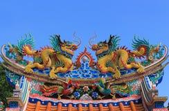Drago gemellare sul tetto Fotografia Stock