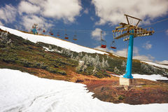 Dragobrat, the spring Carpathians. Spring in the Ukrainian Carpathians against the backdrop of wild snow tops and frosted spruces are shelters and ski slopes Stock Image