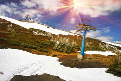 Dragobrat, the spring Carpathians. Spring in the Ukrainian Carpathians against the backdrop of wild snow tops and frosted spruces are shelters and ski slopes Stock Photos