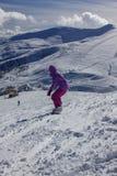 Dragobrat Ukraine. Alpine scenic Ski resort. Young woman snowboarder at mountain Peak Royalty Free Stock Photos