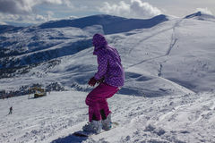 Dragobrat Ukraine. Alpine scenic Ski resort. Young woman snowboarder at mountain Peak Stock Images