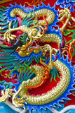 Dragon. Gold various colour dragons on temple Chinese wall s in Bangkok , Thailand Royalty Free Stock Photo