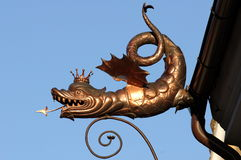 Dragon. Bronze dragon on the Dragon House in the medieval town Brasov Transylvania stock photo