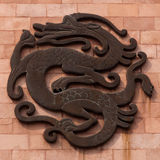 Dragon. Pattern of the decoration on the yellow wall stock image