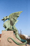 Dragon. A statue of a dragon seems ready to fly off on the Dragon Bridge (Zmajski Most) in Ljubljana, the capital of Slovenia. The bridge from 1900-1901 is Royalty Free Stock Images
