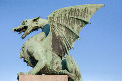 Dragon. A statue of a dragon seems ready to fly off on the Dragon Bridge (Zmajski Most) in Ljubljana, the capital of Slovenia. The bridge from 1900-1901 is Royalty Free Stock Photo
