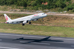 Dragon air take off from phuket airport Royalty Free Stock Photo