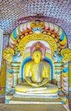 The Dragon Arch of Paccima Temple in Dambulla. DAMBULLA, SRI LANKA - NOVEMBER 27, 2016: The Buddha statue in the colorful Dragon Arch in Paccima Viharaya Western Stock Images
