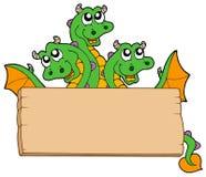 Dragon avec le signe en bois Images libres de droits