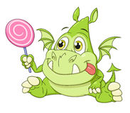 Dragon baby with candy Royalty Free Stock Photos