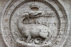 Dragon basrelief. Marble basrelief with a dragon spitting flames Stock Photo
