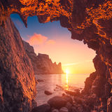 Dragon bay. Beautiful sunrise from the mountain cave in a Crimea sea bay Royalty Free Stock Photo