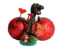 Dragon bearing a gift for Christmas Royalty Free Stock Photos