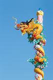 Dragon bind pillar. The old statue of gold dragon bind pillar and blue sky Stock Images