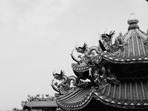 Dragon black and white. Dragon lotus Chinese gold roof chinaculture temple stock photography