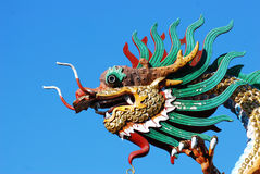 Dragon on blue sky Stock Photo