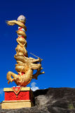 Dragon with a blue sky Stock Photos