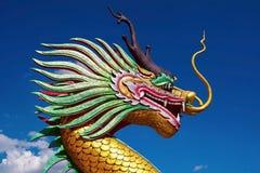Dragon with blue sky. At wat huey pla kunk , chiangrai , thailand Stock Photo
