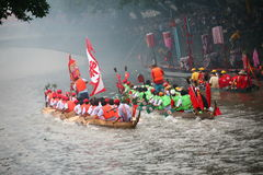 Dragon boat. The picture take on 06.12.2010. Chinese people row the dragon boat on lunar calendar 5/MAY Stock Photos